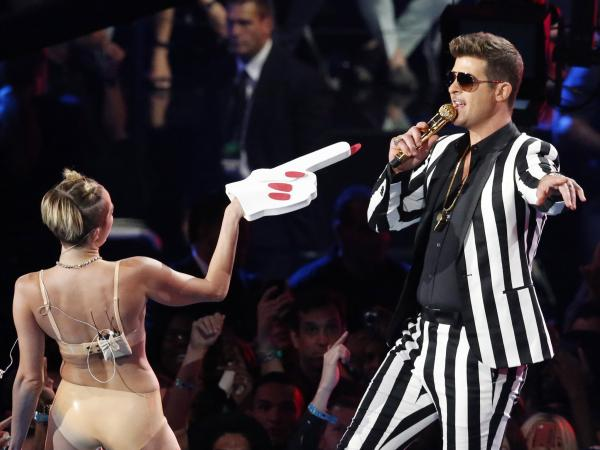 Singers Miley Cyrus and Robin Thicke during Sunday night's MTV Video Music Awards in New York. Her twerking raised many eyebrows.