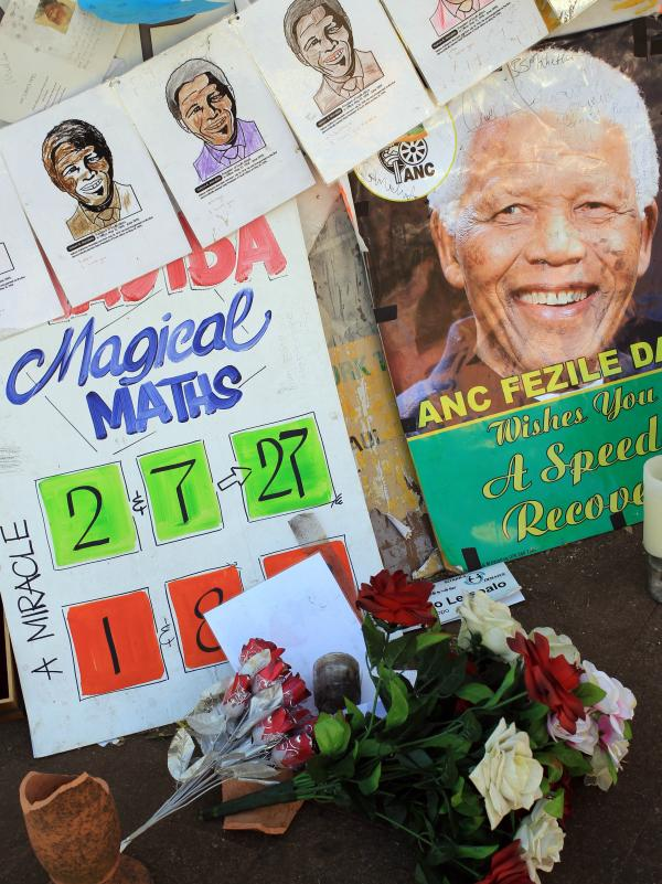 A portrait of former South African President Nelson Mandela with get well messages Saturday outside the hospital where he was treated for a lung infection.