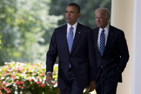 Vice President Joe Biden, right, and President Barack Obama arrive to make a statement about the ongoing situation in Syria in the Rose Garden of the White House on Saturday, Aug. 31, 2013 in Washington. (Evan Vucci/AP)