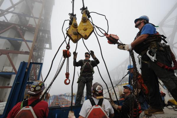 Ironworkers installing northwest chimney on top of the tower, 2011. (Copyright © Joseph A. Blum)