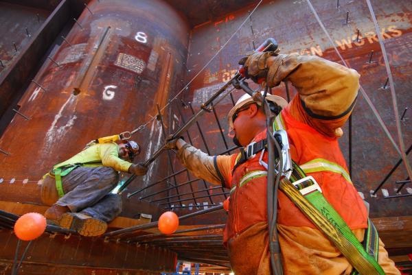 Pile drivers welding studs on E2 foundation, 2007. (Copyright © Joseph A. Blum)