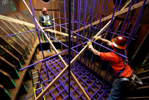 Ironworker Joe Bell and partner checking rebar measurements inside the tower foundation T1, 2007. (Copyright © Joseph A. Blum)