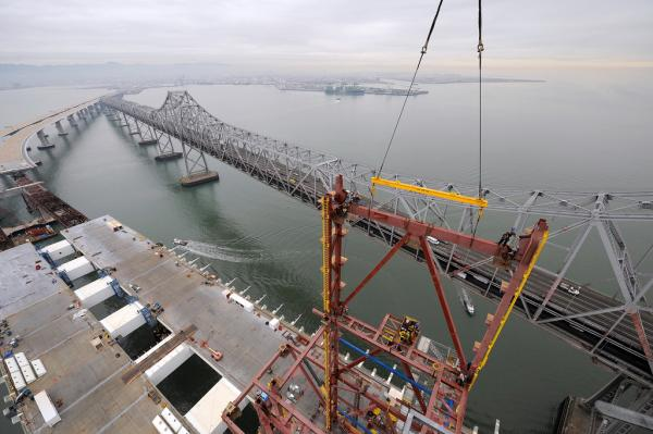Ironworker erecting gang installing chevron truss on temporary tower, 2010. (Copyright © Joseph A. Blum)