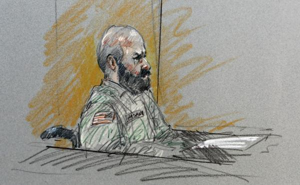 Maj. Nidal Malik Hasan sits in court for his court-martial in Fort Hood, Texas, in this Aug. 6, 2013, courtroom sketch. (Brigitte Woosley/AP)