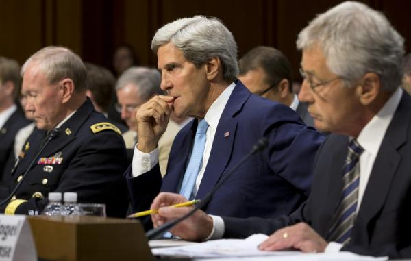 From left, Joint Chiefs Chairman Gen. Martin E. Dempsey, Secretary of State John Kerry, and Defense Secretary Chuck Hagel, listen on Capitol Hill in Washington, Tuesday, Sept. 3, 2013, during a Senate Foreign Relations Committee hearing on Syria. (Jacquelyn Martin/AP)