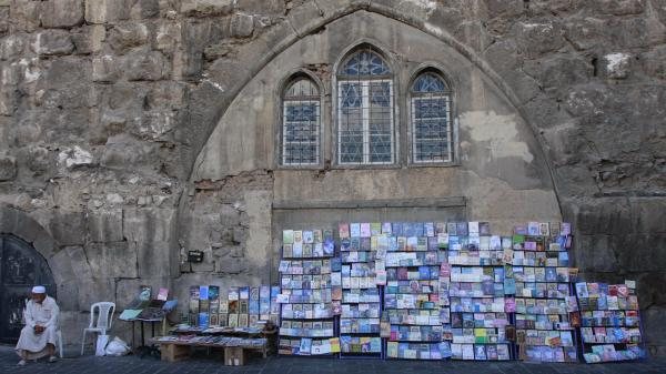 A Syrian book vendor waits for customers at his street stall in the old city of Damascus, Syria, on Sept. 24, 2011.