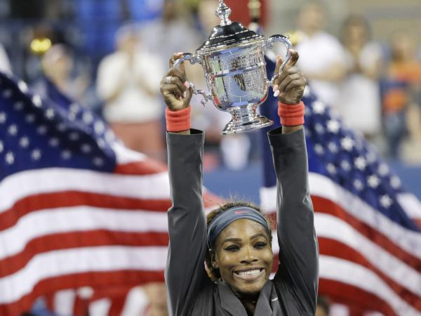 Serena Williams holds up the championship trophy after defeating Victoria Azarenka, of Belarus, during the women's singles final of the 2013 U.S. Open tennis tournament on Sunday in New York.