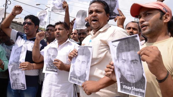 During a demonstration Wednesday, Indian activists hold posters of the four men convicted in the New Delhi gang rape case that shocked the country.