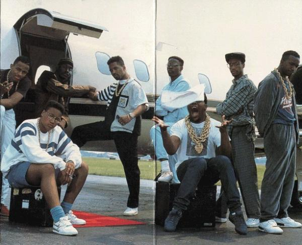 The Juice Crew on the back of <em>In Control Vol. 1</em>. From left to right standing: MC Shan, Big Daddy Kane, Marley Marl, DJ Polo, Masta Ace and Kool G Rap. Seated: Craig G and Biz Markie.