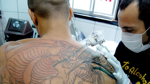 "As NPR's Scott Simon observes, a lot of tattoo parlors' business comes from walk-in clients ""who want to leave with a dragon on their shoulder."" That's the case whether the tattoo shop is in Washington, D.C., or — as in this image — in Sao Paulo."