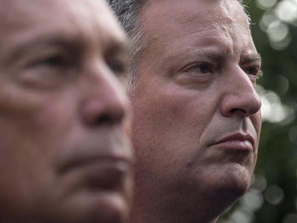Democrat Bill de Blasio, right, stands near the man he'd like to succeed in office — New York Mayor Michael Bloomberg  — during ceremonies Wednesday marking the anniversary of the 9/11 attacks. De Blasio easily outdistanced a handful of opponents in Tuesday's Democratic primary, but a recount is needed to see if he topped the 40 percent threshold to avoid a runoff.