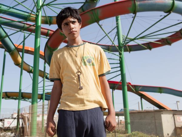 Even with the severity and danger of their situation, Fahed and Yoni enjoy a stop at an abandoned amusement park.