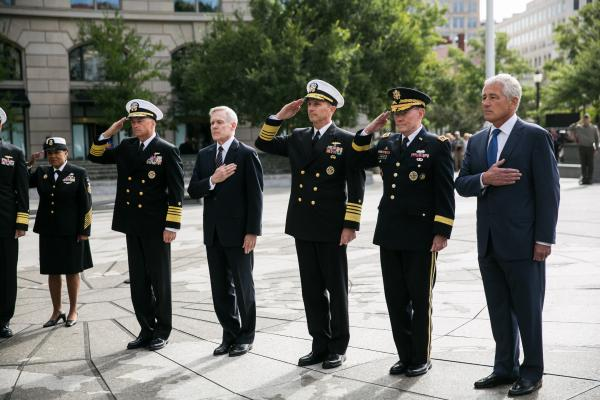 Chief of Naval Operations Jonathan Greenert (left), Navy Secretary Ray Maybus, Vice Chairman of the Joint Chiefs of Staff Sandy Winnfeld, Chairman of the Joint Chiefs of Staff Gen. Martin Dempsey, and Secretary of Defense Chuck Hagel participate in wreath-laying ceremony to honor the shooting victims, at the U.S. Navy Memorial in Washington, D.C., on Tuesday.