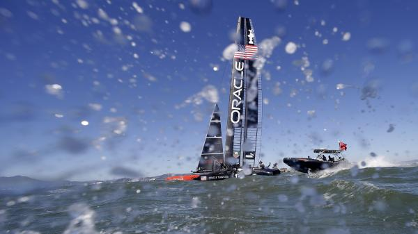 Oracle Team USA heads to the waterfront after winning the ninth race of the America's Cup with a 47-second victory over Emirates Team New Zealand.