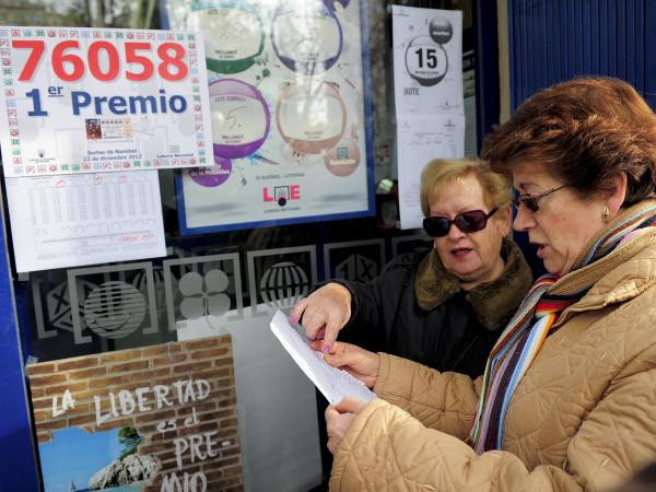 "Women in Barcelona check their numbers for Spain's Christmas lottery, named ""El Gordo"" (Fat One), in 2012."