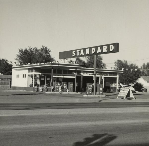 Ed Ruscha'€™s first artist book <em>Twentysix Gasoline Stations</em> featured simple black-and-white snapshots of gas stations that he photographed along Route 66 on his road trips from Los Angeles to Oklahoma City. The book would go on to influence a generation of artists with its industrial style and casual look.