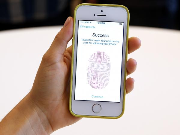 The new iPhone 5s with fingerprint-unlocking technology is displayed during an Apple product announcement Sept. 10 in Cupertino, Calif.