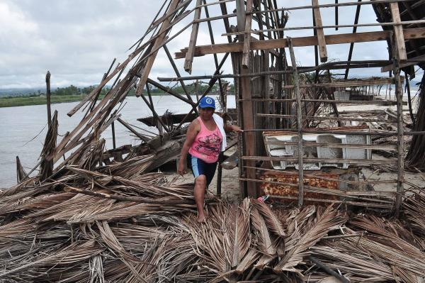 A resident of Barra de Coyuca checks the destruction in a tourist resort close to Acapulco on Thursday.