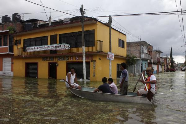 Streets in Tixtla were flooded. Storms have inundated vast areas of Mexico since late last week, destroying roads and bridges, and triggering landslides that buried homes.