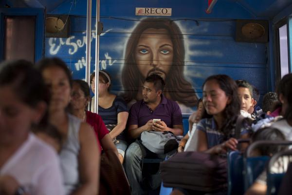 Residents from La Pintada are shuttled from a temporary shelter at the convention center to another site in Acapulco.