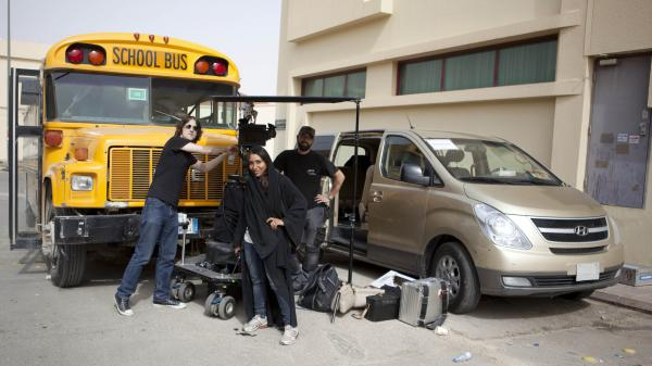 Women aren't permitted to travel unattended in the streets of Saudi Arabia, so <em>Wadjda</em> director Haifaa Al Mansour worked from inside a van, communicating with her crew via walkie-talkie.