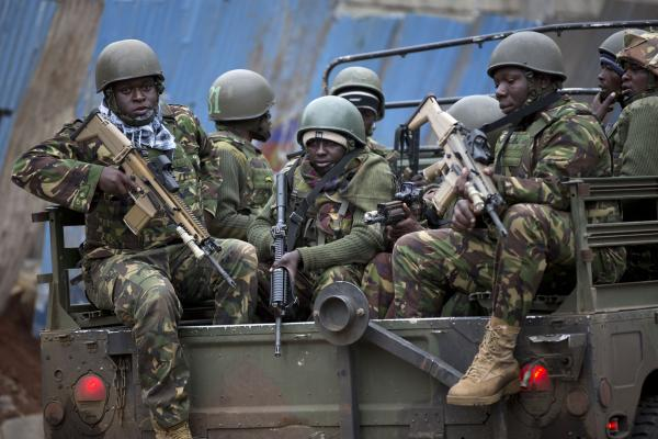 Kenyan soldiers arrive at the mall after dawn. Al-Shabab has warned that it would attack Kenya in retaliation for the country's sending troops to Somalia in 2011.