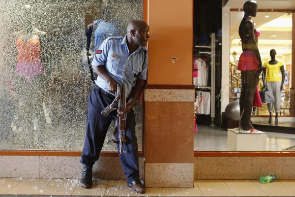 A police officer tries to secure an area inside the mall.