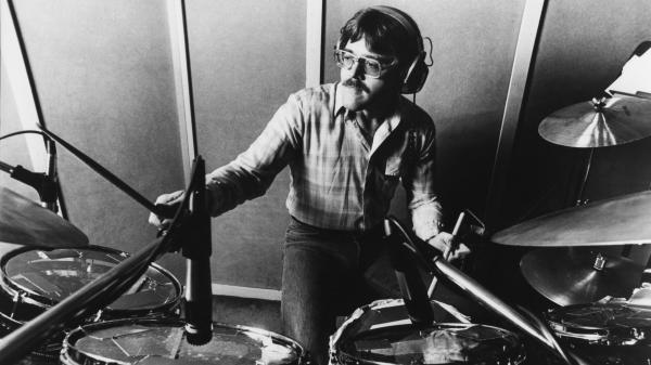 Roger Hawkins, a member of the Muscle Shoals Rhythm Section (also known as the Swampers), is just one among the many musicians captured in this documentary about the famous town.