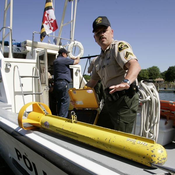 Capt. Paul Carey of the Maryland Natural Resources police shows a side-scan sonar being used in a search on the Chesapeake Bay in 2006. In recent years, the cost of such equipment has come down, allowing more local law enforcement departments to purchase it.