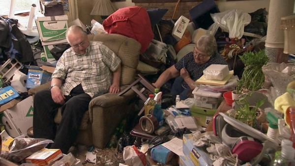 Gordon and his wife from the season premiere of the A&E show <em>Hoarders</em>. (A&E doesn't fully identify people who get treatment through their show.)
