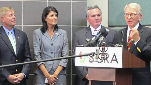 South Carolina Republican Sen. Lindsey  Graham (from left), Gov. Nikki Haley and state House Speaker Bobby Harrell listen to Charleston Mayor Joseph Riley Jr. criticize a National Labor Relations Board complaint against Boeing in North Charleston, S.C., on April 21.