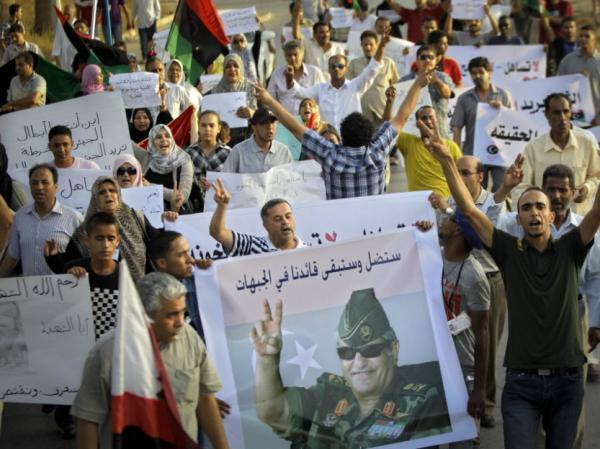Libyans shout slogans at a rally in rebel-held Benghazi, in eastern Libya on July 31. The rally was held to  pay respect to Abdel-Fattah Younis, the Libyan rebels' slain military chief. Now, his family, tribesmen and supporters are demanding answers from the rebel authorities about his death.