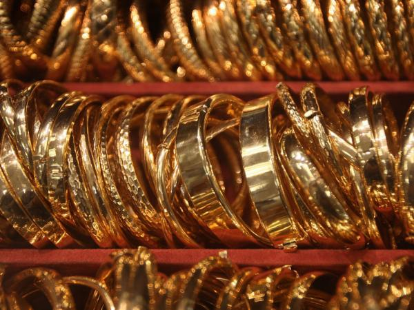 Gold futures climbed above $1,700 an ounce Monday as investors eyed the precious metal as a safe haven from declining stock markets.