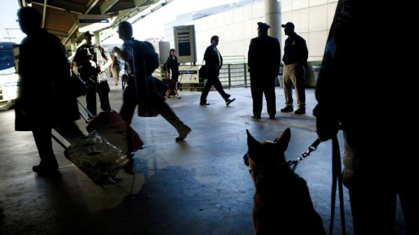 "An Amtrak Police K-9 watches while commuters depart for rush hour during ""Operation Railsafe"" at Union Station in Washington, D.C., last October."