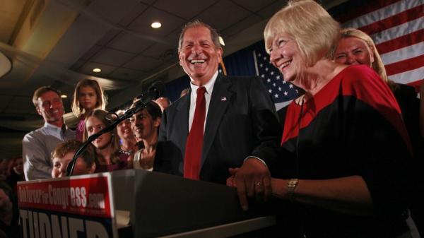 "Bob  Turner, center, joined by his wife Peggy,  right, and family smiles as he  delivers his victory speech during an  election night party in New York.  Turner says his shocking win in a heavily Democratic New York City district is a ""loud and clear"" message to Washington."
