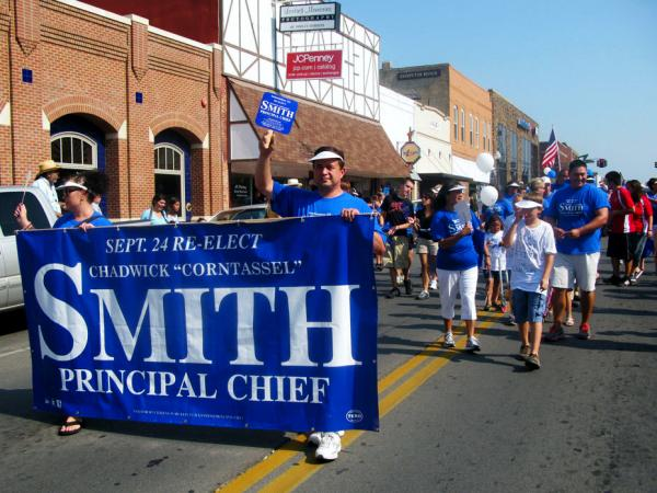 Supporters of Chad Smith take part in the Cherokee National Holiday parade on Sept. 3 in Tahlequah, Okla., the heart of Cherokee country, on Labor Day weekend. Smith was tribal chief from 1999 until earlier this year. He is hoping to win re-election later this month. The federal government says it won't recognize the election results.