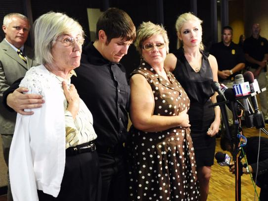 The family of slain police officer Mark MacPhail speaks to the media after the pardons board refused to grant clemency to Troy Davis. They are (from left) mother Anneliese MacPhail; MacPhail's son, Mark Jr.; wife Joan; and daughter Madison.