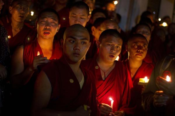 Exile Tibetan monks hold a candle light vigil in Dharmsala, India, as they react to news reports of self-immolation by two Tibetan monks at the Kirti Monastery in Sichuan province's Aba prefectuture, China.