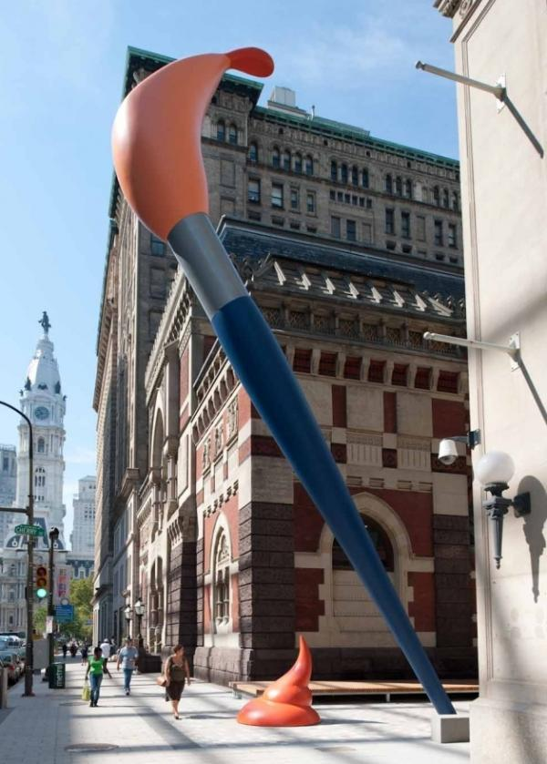 Oldenburg's 50-foot-tall <em>Paint Torch </em>towers over pedestrians at the Pennsylvania Academy of the Fine Arts.