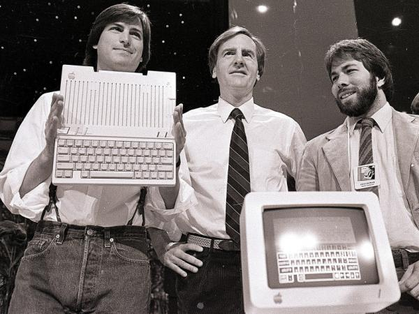 <p>April 24, 1984, from left to right: Steve Jobs, John Sculley and Steve Wozniak unveil the new Apple IIc computer in San Francisco.</p>