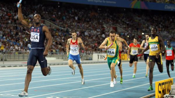 <p>LaShawn Merritt crosses the finish line first, in the men's 4x400-meter relay at the IAAF World Athletics Championships in Daegu, South Korea, Sept. 2. Once banned for doping, Merritt has been cleared to run in London next summer.</p>