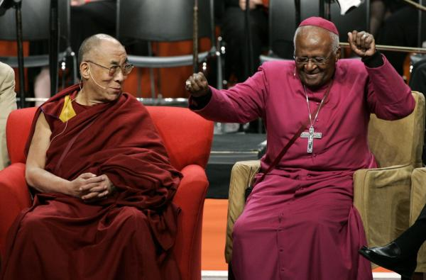 <p>The Dalai Lama looks on as Tutu does a dance after remarking that his wireless microphone made him feel like pop star Michael Jackson, during an event at the University of Washington in Seattle in 2008.</p>