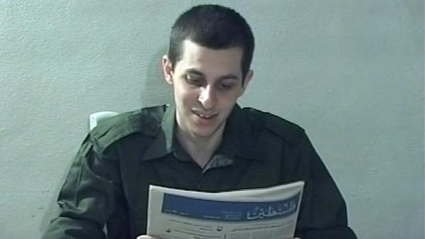 <p>In this file image taken from a video released by Hamas in 2009, Israeli soldier Gilad Schalit is seen holding a newspaper in an unknown location. </p>