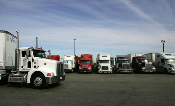 <p>A truck stop near Hesperia, Calif. To address a shortage of truck drivers resulting from a mismatch of skills in the labor market, some trucking companies have started free driving schools with the promise of a job upon completion.</p>