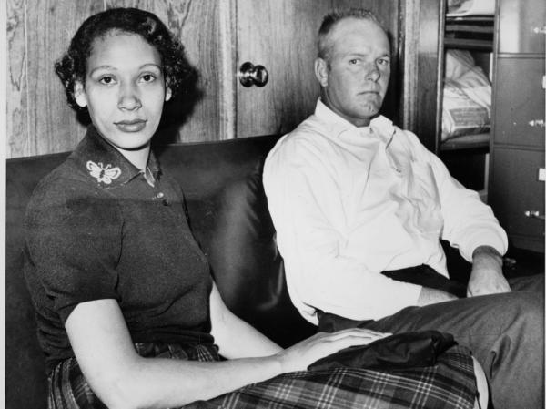 <p>Richard P. Loving and his wife, Mildred, on Jan. 26, 1965. Residents of Caroline County, Va., the Lovings married in Washington, D.C., in 1958. Upon their return to Virginia, the interracial couple was convicted under the state's law that banned mixed marriages. They eventually won a U.S. Supreme Court decision in June 1967 that overturned laws prohibiting interracial unions.</p>