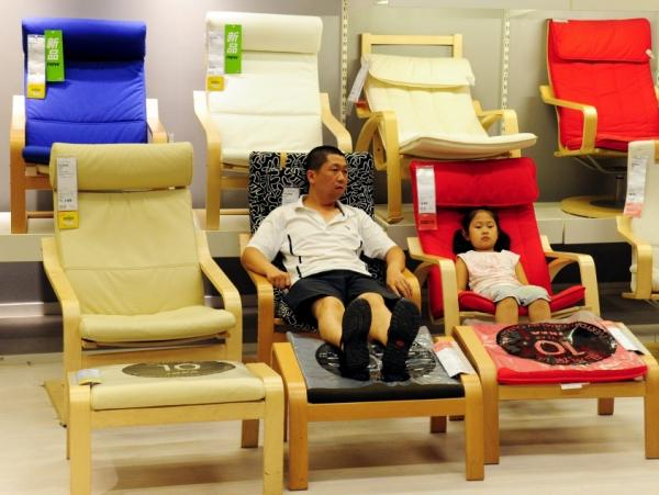 <p>Chinese shoppers try out products at an IKEA store in Beijing. IKEA has many functions for different people. While some go to buy furniture, some go to lounge around and still others to date. </p>