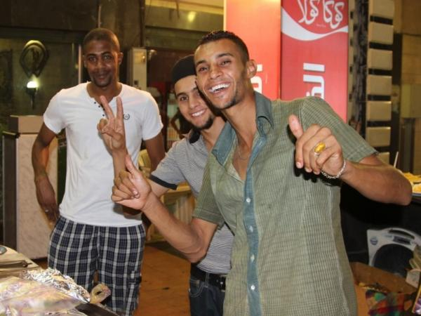 Young men in Tripoli. Many say they like the idea of laws being based on traditional Sharia concepts.