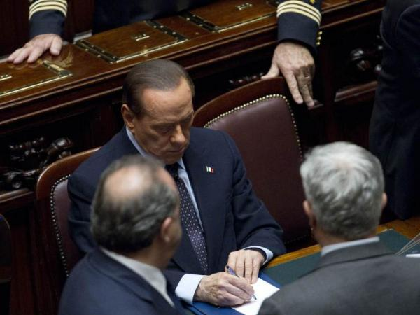Italian Premier Silvio Berlusconi promised Tuesday to resign after parliament passed economic reforms demanded by the European Union. The debt crisis in Europe has been compounded by political problems.