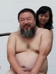 Chinese artist Ai Weiwei (C) posing with women in the nude in Beijing.