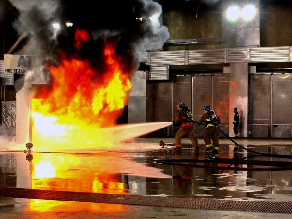 Firefighters in the ATF's Fire Research Lab battle a mock fire. The lab is the only facility of its kind in the world to provide the necessary facilities, equipment and staff to work on important fire investigation issues.
